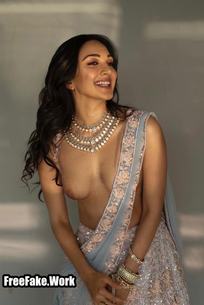 Kiara-Advani-without-blouse-naked-small-boobs-half-saree-pic.jpg